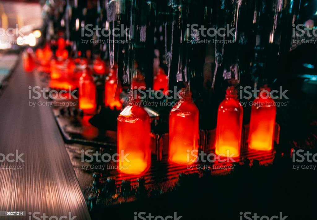 A picture of a glass factory making bottles stock photo
