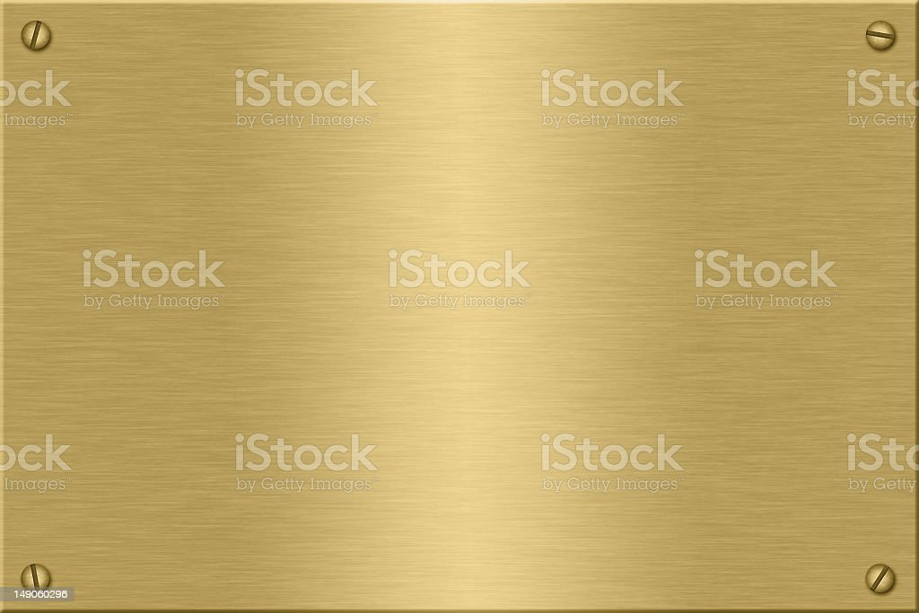 A picture of a gold plate with 4 screws stock photo