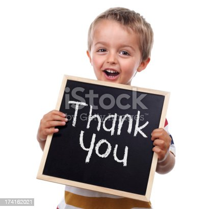istock A picture of a little boy holding a thank you sign 174162021