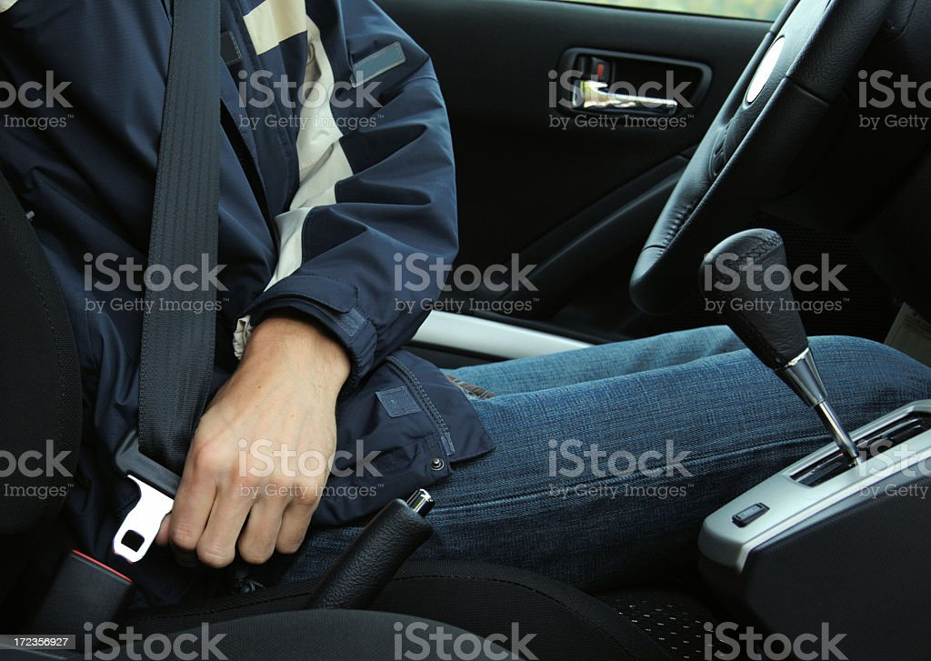 A picture of a man buckling his seat belt royalty-free stock photo