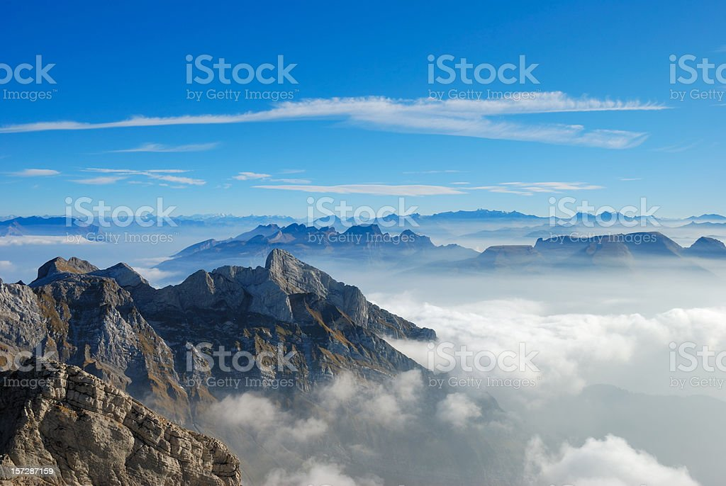 Picture of a mountain top from above the clouds stock photo
