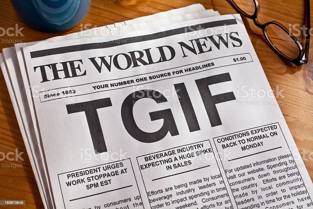 Picture of a newspaper with the phrase TGIF stock photo
