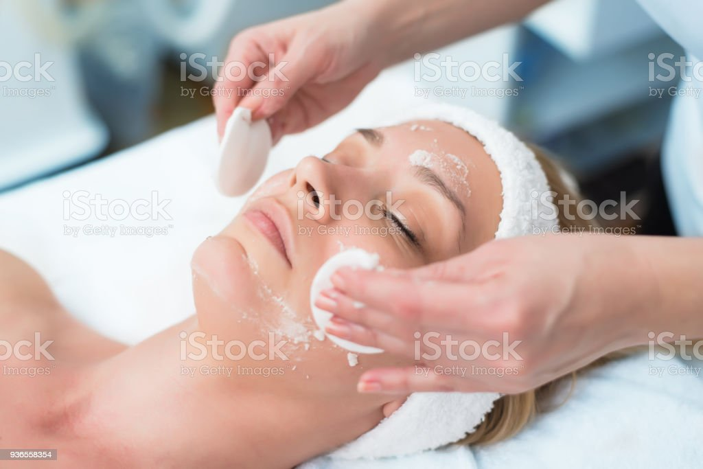 Picture of a person receiving facial exfoliation stock photo