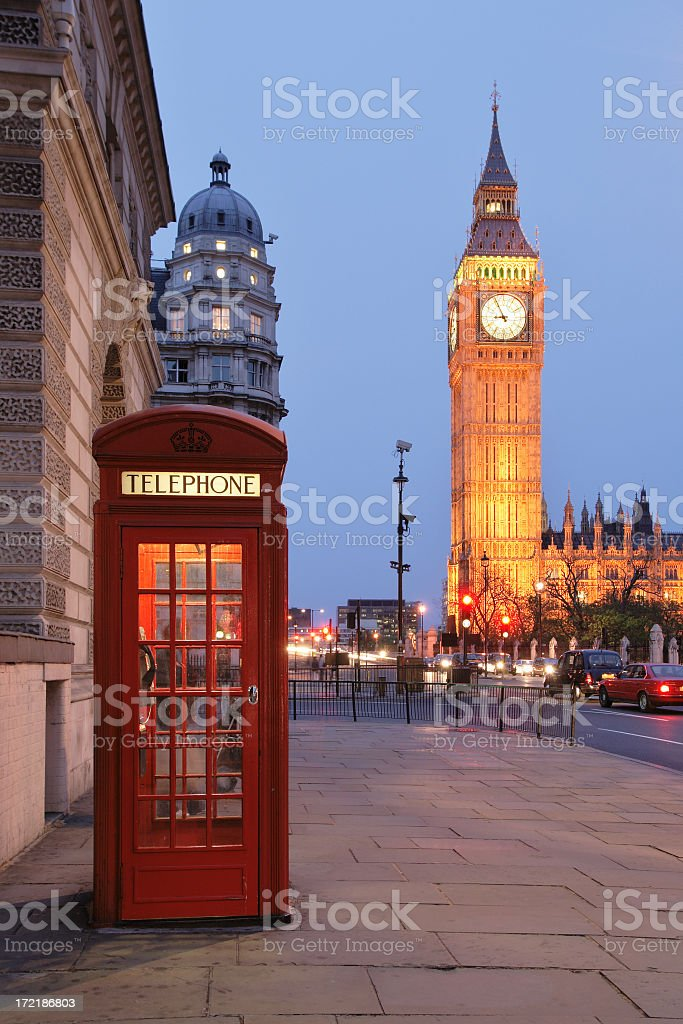 Picture of a red phone booth with Big Ben in the background royalty-free stock photo