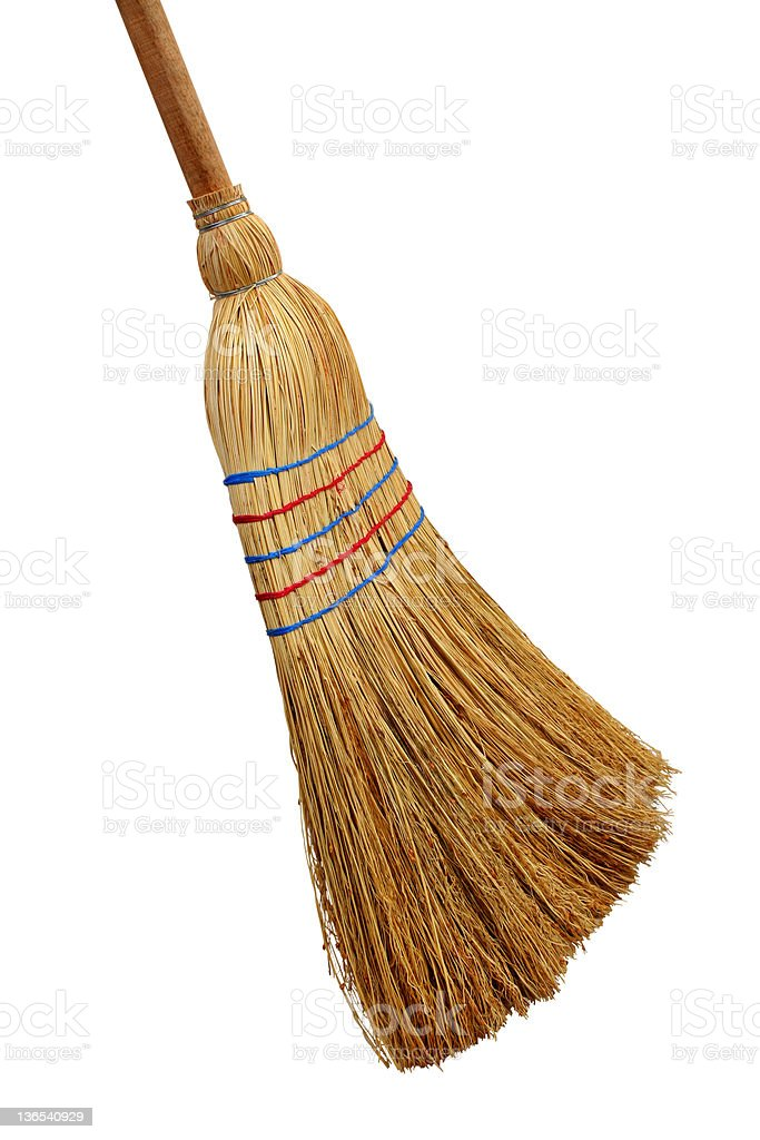 Picture of a straw broom on a white background stock photo
