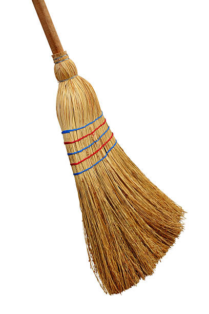 Picture of a straw broom on a white background Broom isolated on white background. broom stock pictures, royalty-free photos & images