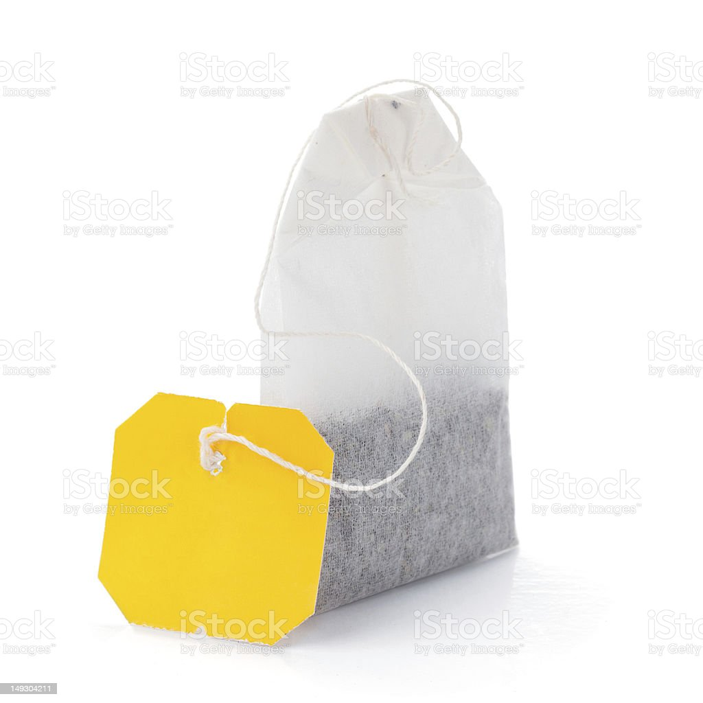 A picture of a teabag with a yellow label stock photo