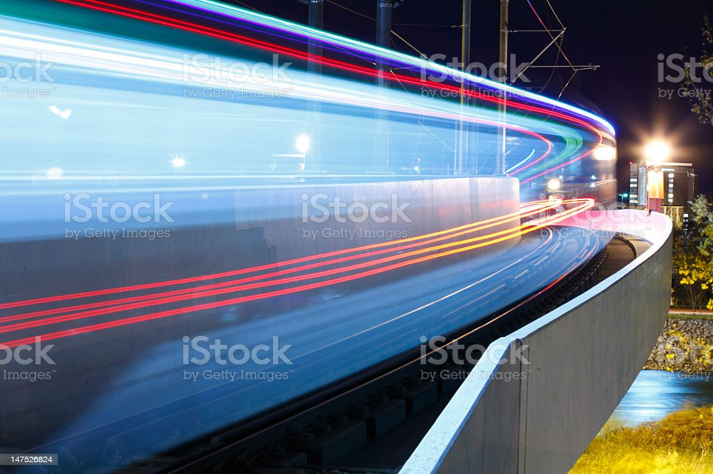 Picture of a train passing quickly at night stock photo