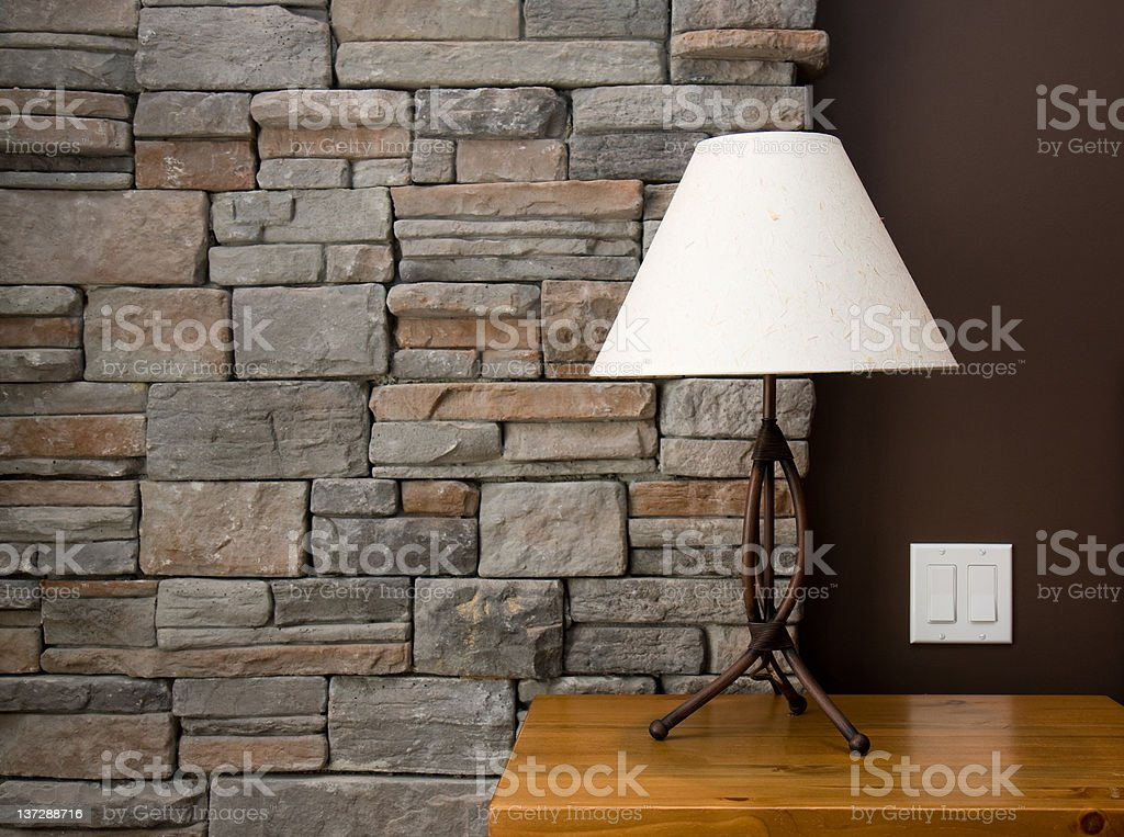 A picture of a white lamp on a night stand stock photo
