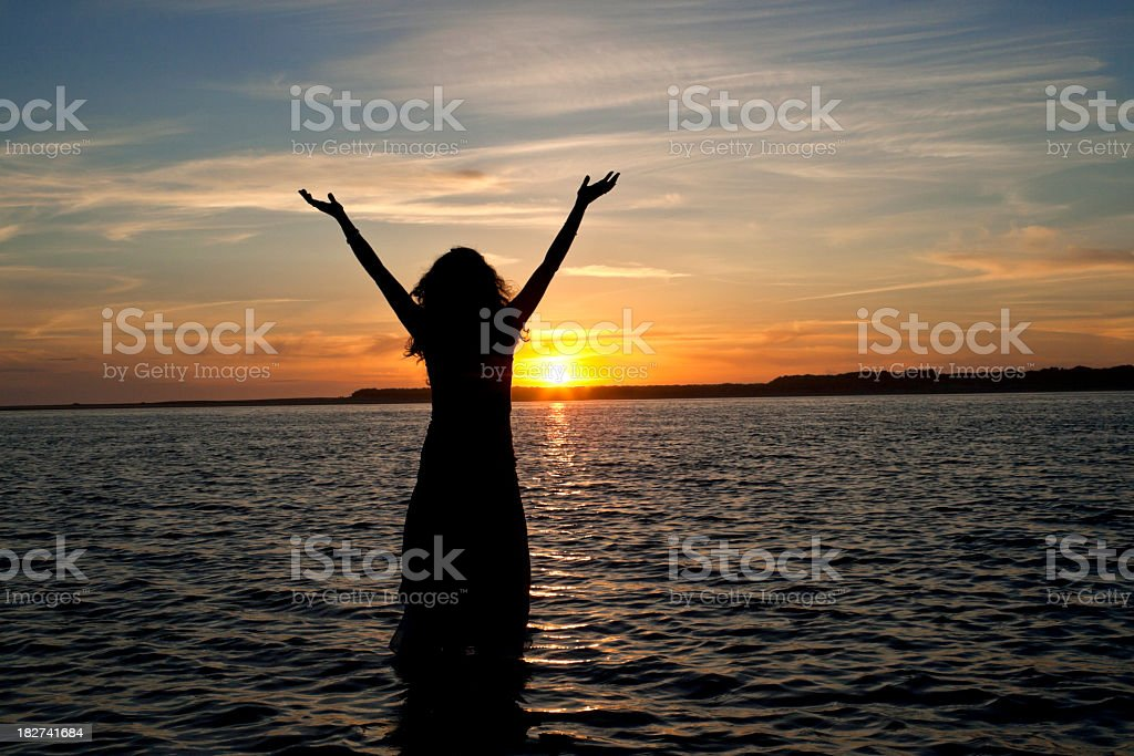 A picture of a woman on the beach stock photo