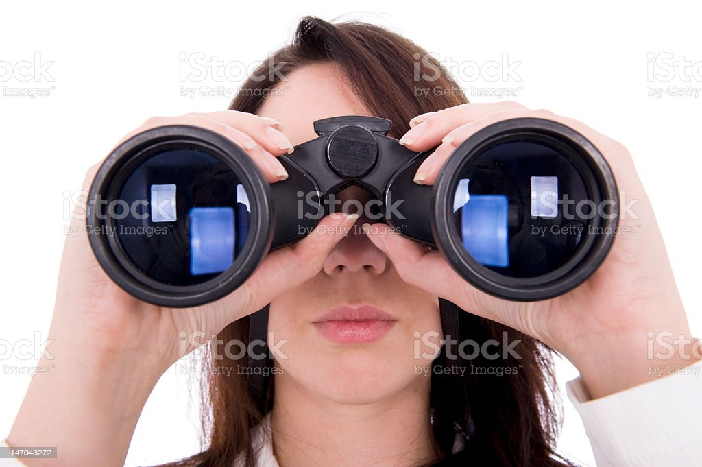 A picture of a woman using binoculars stock photo