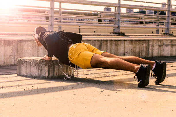 picture of a young athletic man doing push ups outdoors. - mockup outdoor rain foto e immagini stock