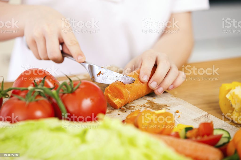 A picture of a young child making a salad stock photo