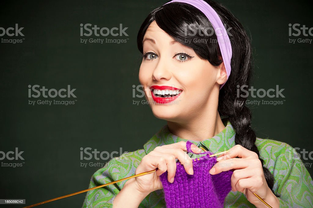 A picture of a young woman knitting royalty-free stock photo