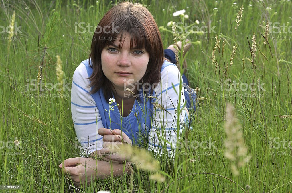 Picture of a young woman lying in the grass royalty-free stock photo