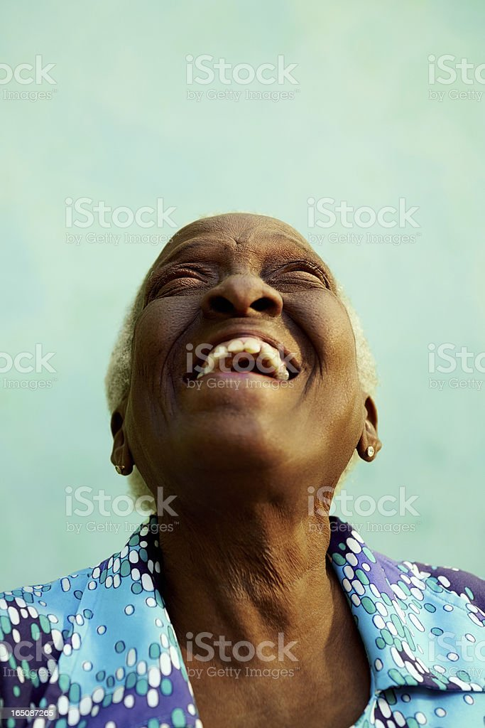 Picture of an elderly woman looking up and laughing stock photo