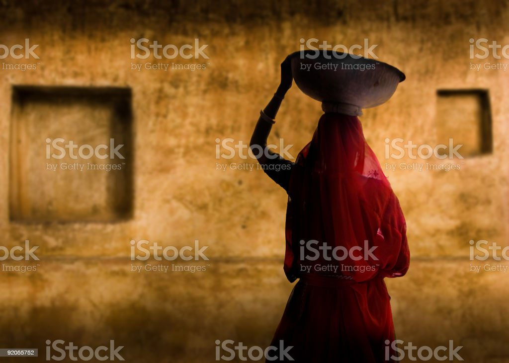 A picture of an Indian woman in a red dress stock photo