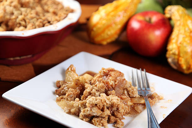 A picture of Apple crisp on a white plate stock photo