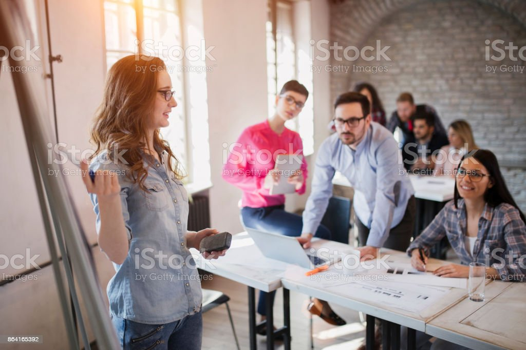 Picture of architect doing presentation to her colleagues royalty-free stock photo