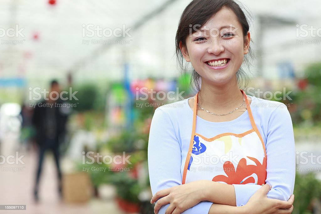 picture of asian female Florist royalty-free stock photo