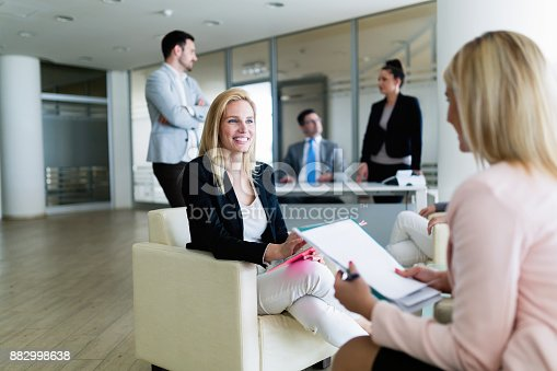 istock Picture of attractive saleswoman working in office 882998638