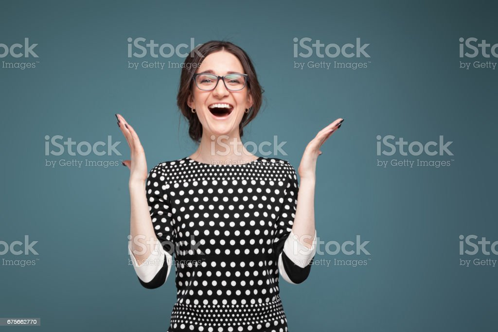 Picture of attractive woman in speckled clothes standing royalty-free stock photo