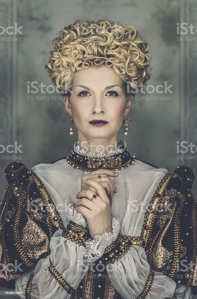 Picture of beautiful haughty queen in royal dress stock photo