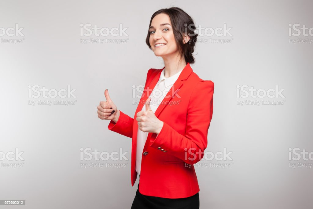 Picture of beautiful woman in red blazer standing royalty-free stock photo