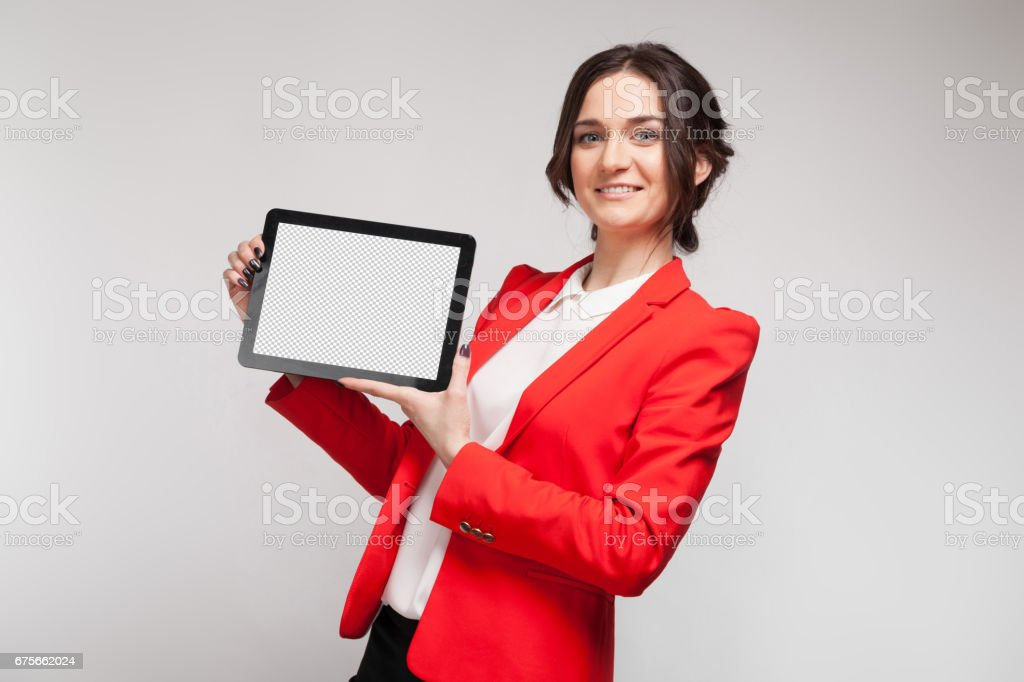 Picture of beautiful woman in red blazer standing with tablet in hands royalty-free stock photo