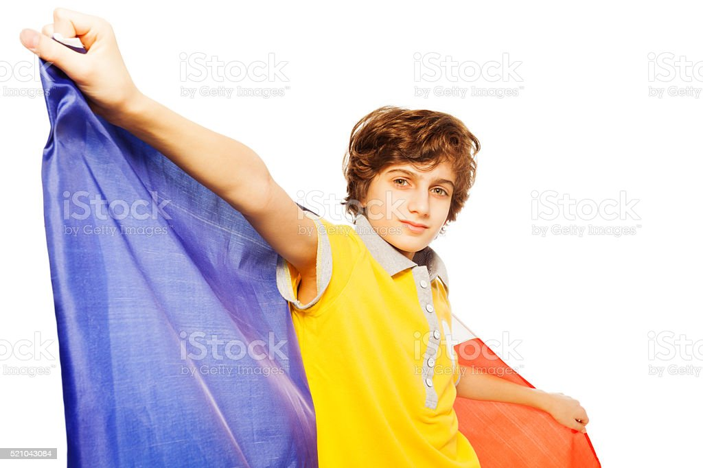 Picture of boy holding French flag behind stock photo