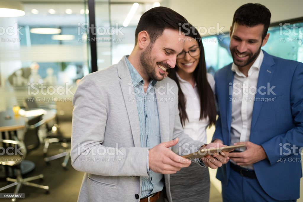 Picture of businesspeople using digital tablet in office royalty-free stock photo