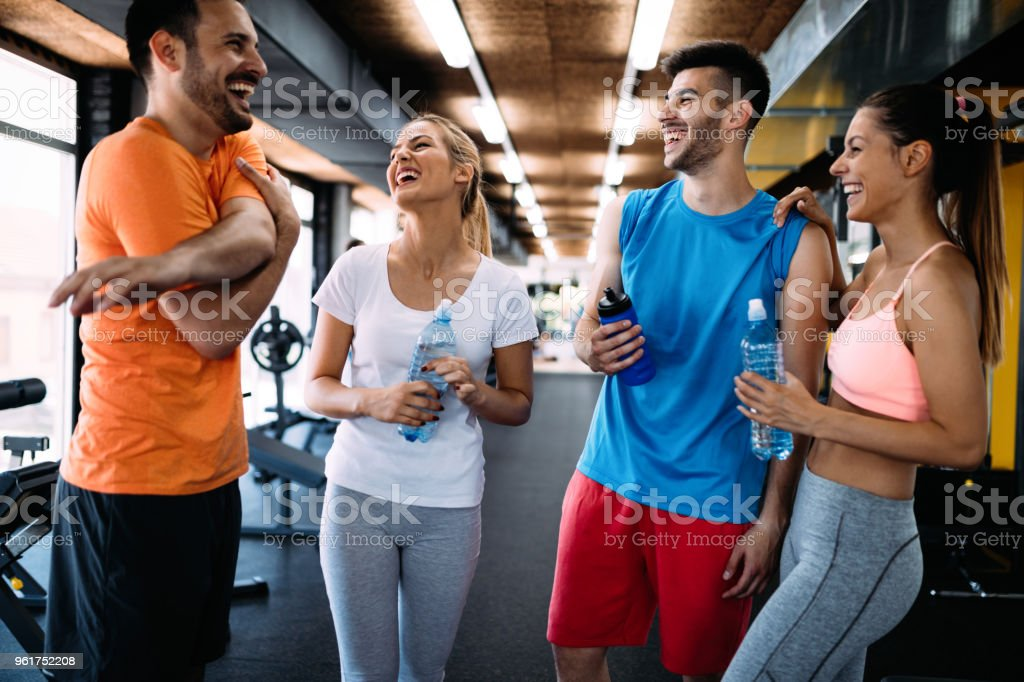 Picture of cheerful fitness team in gym stock photo