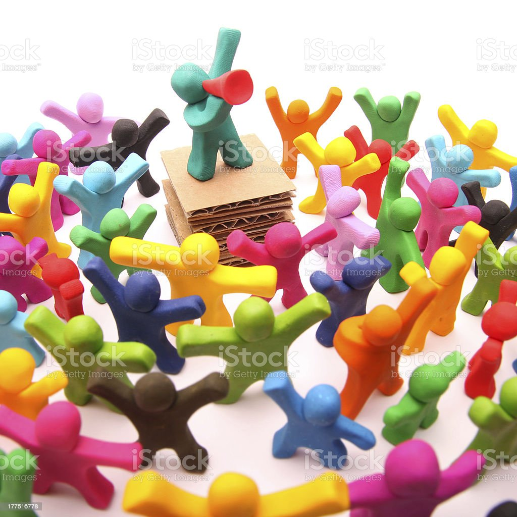 Picture of clay persons during a public speaking stock photo