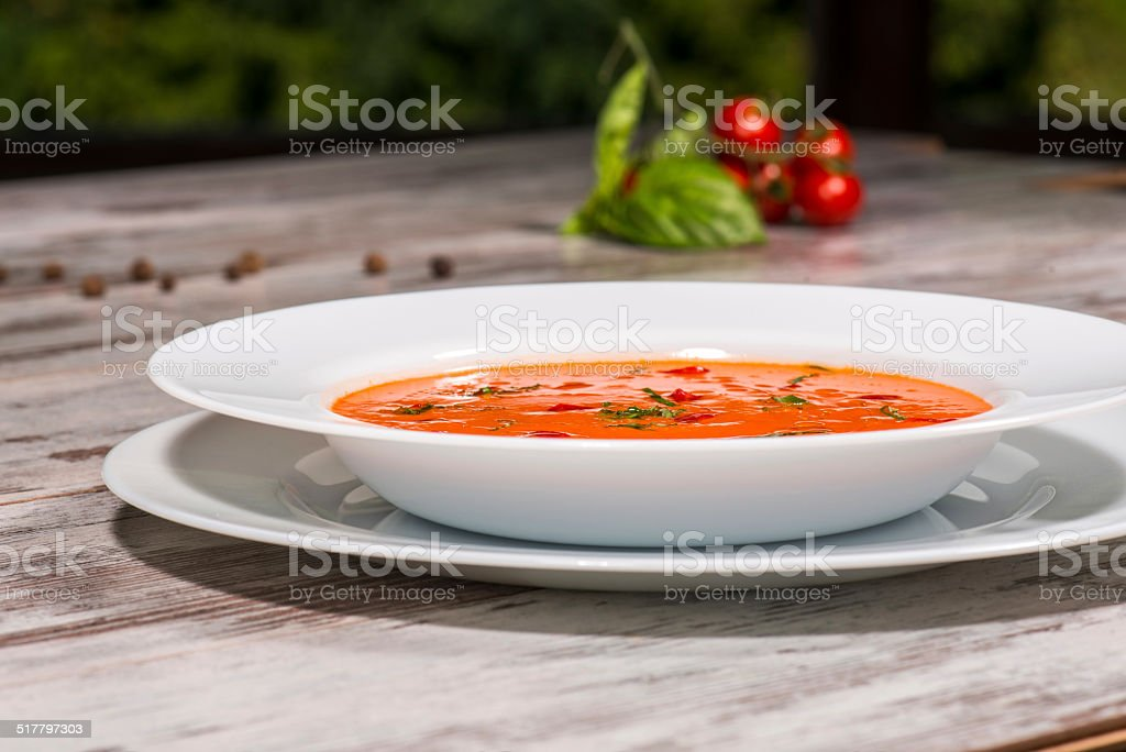 Picture of cold tasty tomato soup gazpacho with species on stock photo