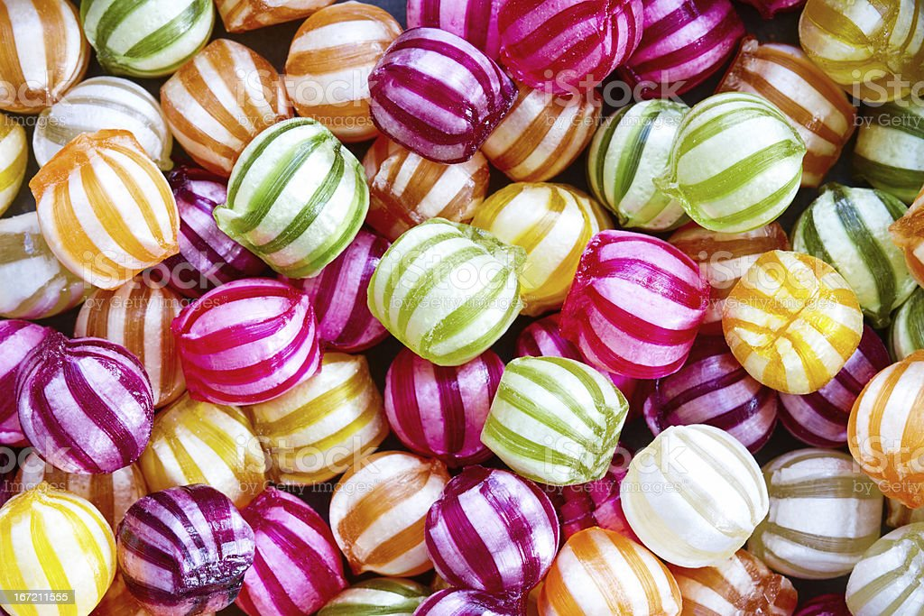 A picture of colorful candies with white striped patterns stock photo