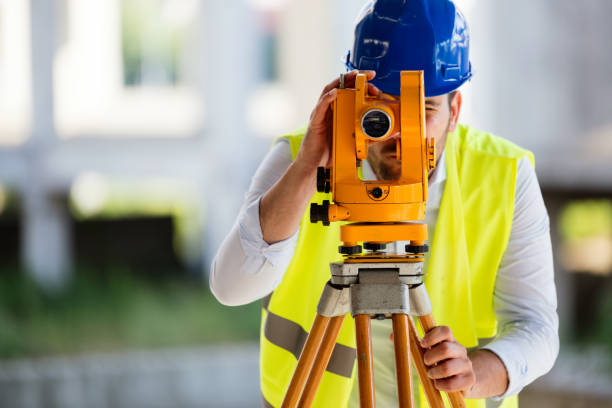 picture of construction engineer working on building site - topography stock photos and pictures