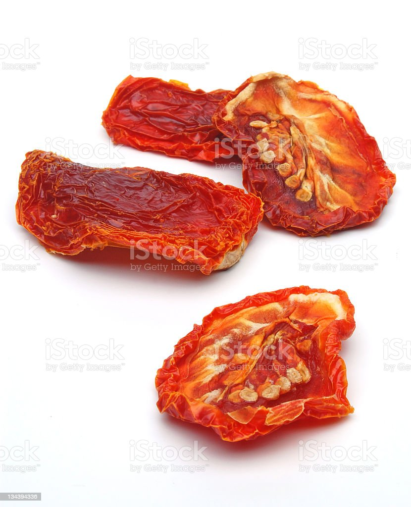 Picture of dried tomatoes on a white background stock photo