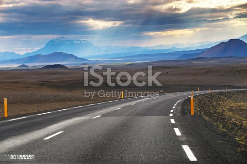 Picture of empty road with mountain Modrudalur and mountain Herdubreid as a background in Iceland, Summertime