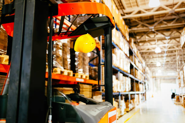 Picture of forklift machine parked in warehouse stock photo