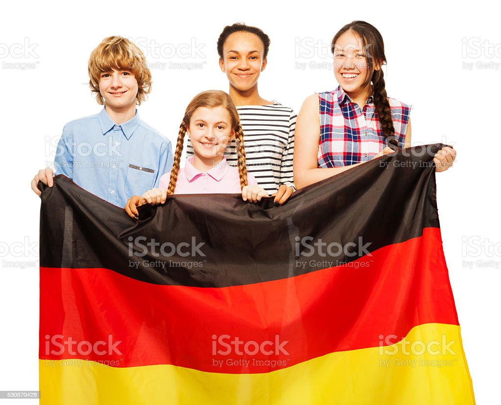 Picture of four teenage kids holding German flag stock photo