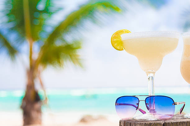 picture of fresh margarita and sunglasses on tropical beach - margarita drink stock photos and pictures
