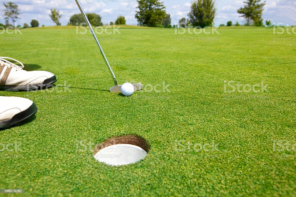 Picture of golfer putting a ball stock photo