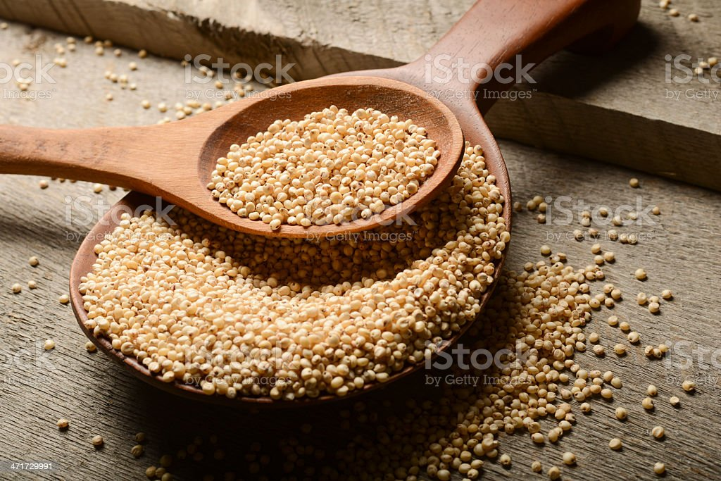 A picture of grains in a wooden spoon stock photo