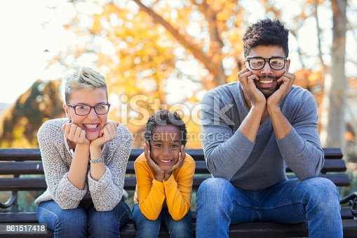 istock Picture of happy young couple spending time with their daughter 861517418