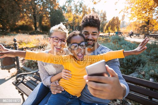 istock Picture of happy young couple spending time with their daughter 862351972