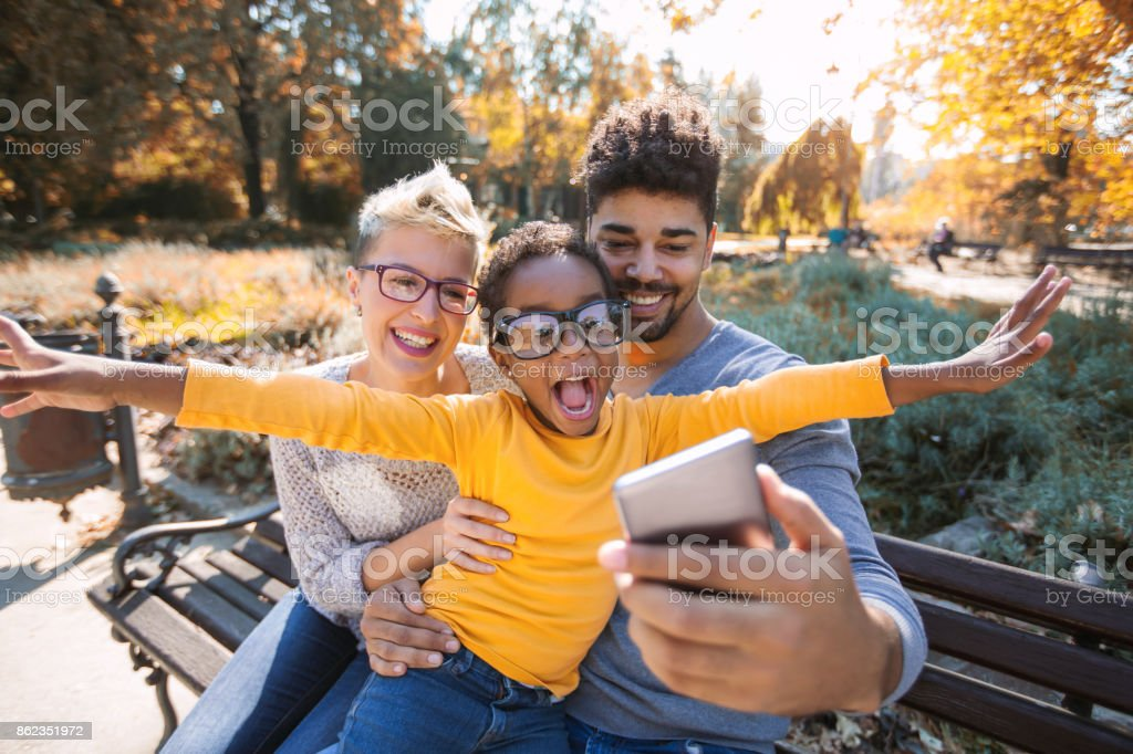 Picture of happy young couple spending time with their daughter - fotografia de stock