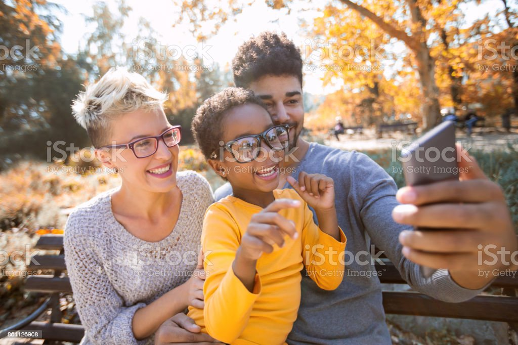 Picture of happy young couple spending time with their daughter royalty-free stock photo