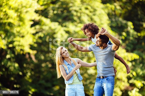 istock Picture of happy young couple spending time with their daughter 950738076