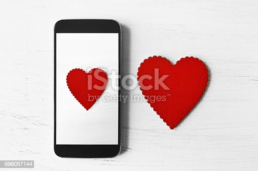 istock Picture of heart on smart phone 596057144