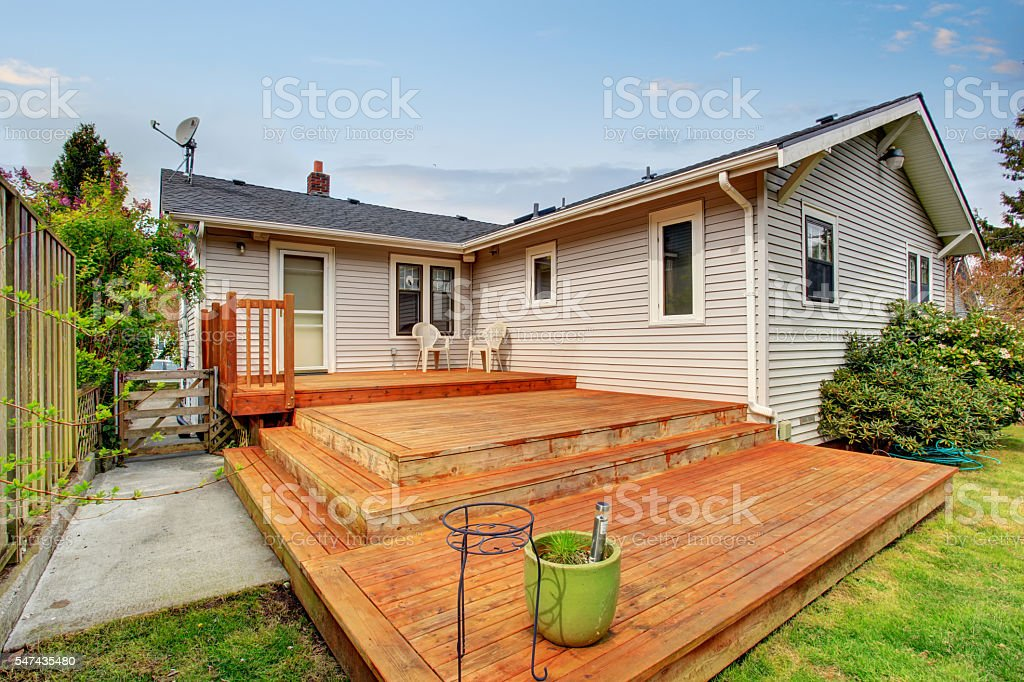 Picture of Large wooden back deck with two chairs. stock photo